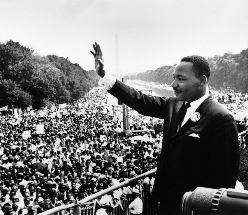 Martin Luther King Jr waving to crowd during
