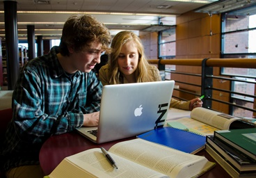 Library studying with laptop